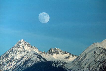 A view of the moon over the mountains above the Salmon River