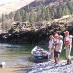 Sturgeon fishing, reeling in the big one with our fishing guides on the Lower Salmon River near Salmon Idaho